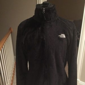 Black fuzzy North Face jacket
